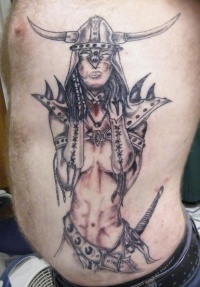 Rib tattoo, equipped fearless warrior